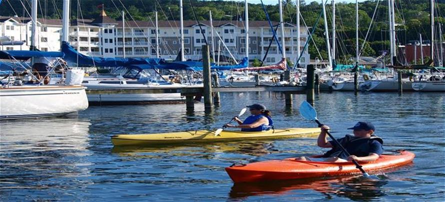 kayakers on seneca lake infront of Watkins Glen Harbor Hotel